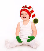 Cute baby playing in a hat and mittens — Stock Photo