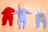 Little cute baby with clothes — Stock Photo