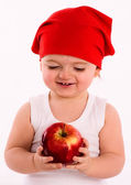 Pretty nice little girl. Close-up in the studio with apple — Stock Photo