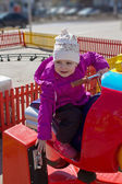 Child in an amusement park — Stock Photo