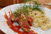 Fried pork ribs with pasta — Stock Photo