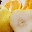 Ripe pear with an orange - Stock Photo