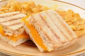 Panini sandwich and corn chips — Stock Photo