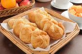 Croissants and fresh fruit — Stock Photo