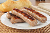 Plate of grilled brats — Stock Photo