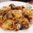 Braised beef tips with tortellini — Stock Photo #9925005