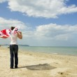 Girl on the beach with a British flag — Stock Photo
