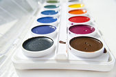 Colorful palette of watercolors . paints box on grey — Stock Photo