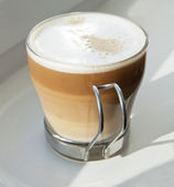 Cappuccino in a glass cup — Stock Photo