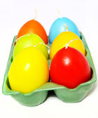 Easter candle in egg form in the box on a white background — Stock Photo