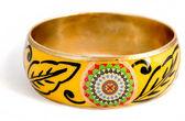Yellow decorative bracelet isolated on white — Stock Photo