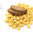 Italian pasta and brown bread over white background - Stock Photo