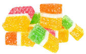 Fruit candy heap isolated on white. — Stock Photo