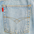 Back pocket of blue jeans close up. — Stock Photo