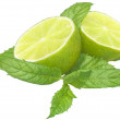 Sliced ​​lime with mint leaves. — Stock Photo
