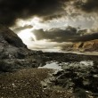 Stock Photo: Dramatic Rocky Beach Landscape