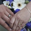 Stock Photo: Wedding rings and bouquet of flowers