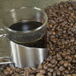 Stock Photo: Fresh cup of coffee and beans