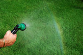 Watering, creating a raindow — Stock Photo