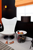 Showcase of interior with leather armchair — Stok fotoğraf