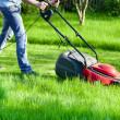Stock Photo: Man with lawnmower