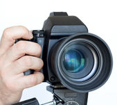 Camera with the lens — Stock Photo