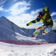 Stock Photo: Snowboarder in free jumping