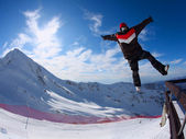 Snowboarder in the free jumping — Stock Photo
