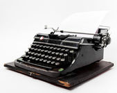 Old typewriter with a sheet of paper — Foto de Stock
