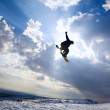 Silhouette the snowboarder in the sky — Stock Photo