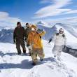 Snowboarders in the mountains — Stock Photo