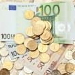 Variety of coins and euro banknotes — Stock Photo