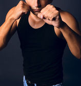 Muscular man in a boxing stance — Stock Photo