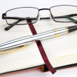 Royalty-Free Stock Photo: Notebook with pen and glasses