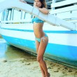 Attractive beautiful woman near the boat — Stock Photo
