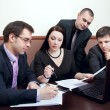 Businesspeople at a meeting in the office - Stock Photo