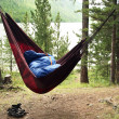 Man sleeps in a hammock and in a sleeping - Stock Photo