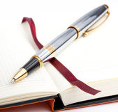 Notebook with bookmark and pen — Stockfoto