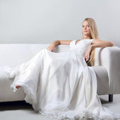 Portrait of the beautiful girl in a wedding dress — Stock Photo