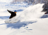 Snowboarder racing down — Stock Photo