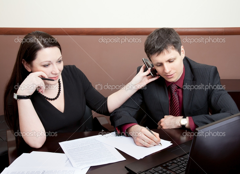 Two modern businesspeople at the meeting in the office  Stock Photo #9290368