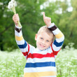 Boy holds a dandelions in hands — Stock Photo #9484880