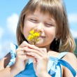Happy young girl with a flower in his hand — Stock Photo