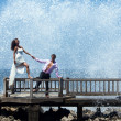 Royalty-Free Stock Photo: Happy young couple walking on the old pier
