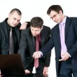 Stock Photo: Three businessmen talking on the computer