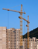 Cranes and building under construction — Stock Photo