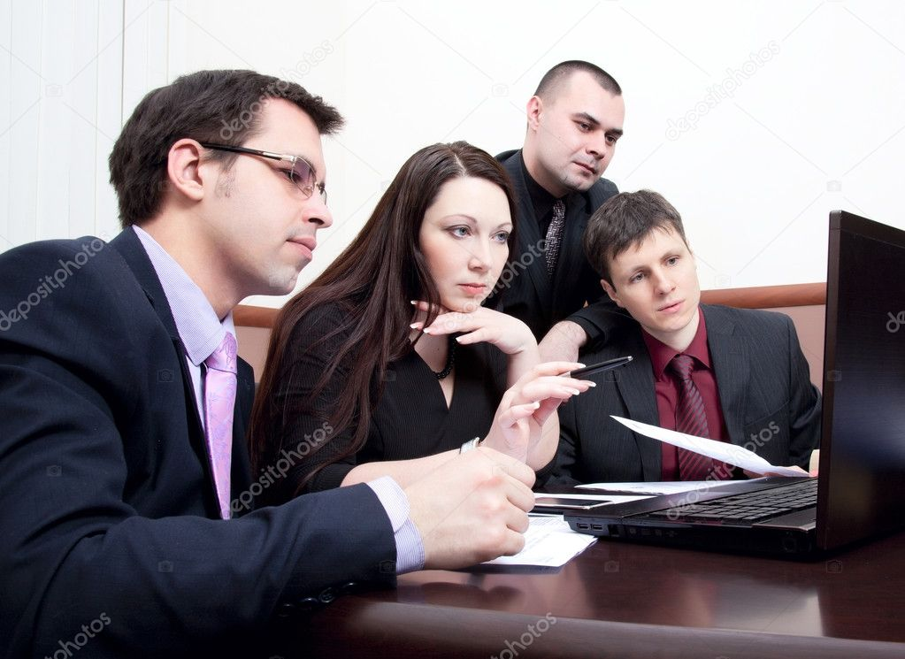 Four modern businessman at the meeting in the office — Stock Photo #9484908