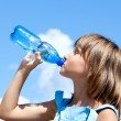 Young beautiful girl drinking water — Stock Photo #9624860