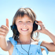 Happy little girl in headphones - Stock Photo
