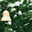 Christmas golden bell on the Christmas tree — Stock Photo